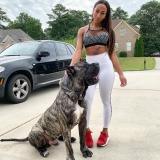 Halani outside with her huge dog.