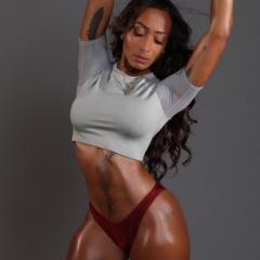 Halani Lobdell modeling body and workout wear.